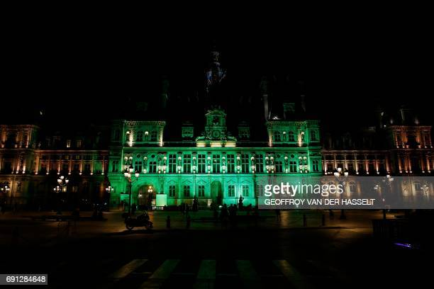 A picture taken on June 1 shows the City Hall of Paris illuminated in green following the announcement by US President Donald Trump that the United...