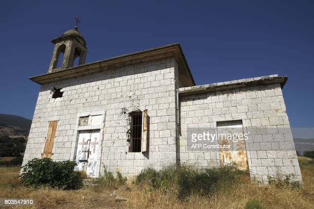 A picture taken on June 12 2017 in the village of Banias in the Israeli occupied Golan Heights shows a general view of a church Few Christians remain...