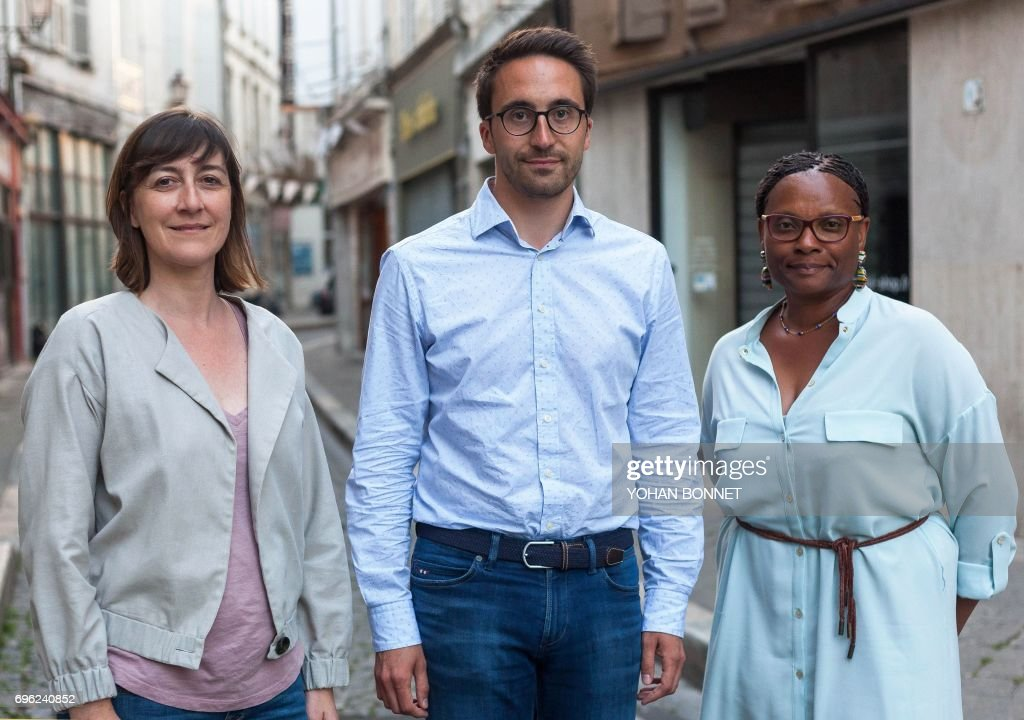 A picture taken on June 12, 2017, shows (L-R) Sandra Marsaud, urbanist, municipal councilor of Saint-Meme-les-Carrieres and French La Republique En Marche (LREM) party candidate in the 2nd constituency of Charente, Thomas Mesnier, emergency doctor and LREM candidate in the 1st constituency of Charente and Madeleine Ngombet-Bitoo, former Socialist regional councilor and LREM candidate in the 3rd constituency of Charente, posing in Angouleme, central France, ahead of the second round of France's legislative elections. France heads to the polls on June 18, 2017, for the second round of legislative elections, with Macron's year-old La Republique En Marche party and its allies tipped to clean up for the 577-member lower house of parliament, winning up to 445 seats. / AFP PHOTO / Yohan BONNET