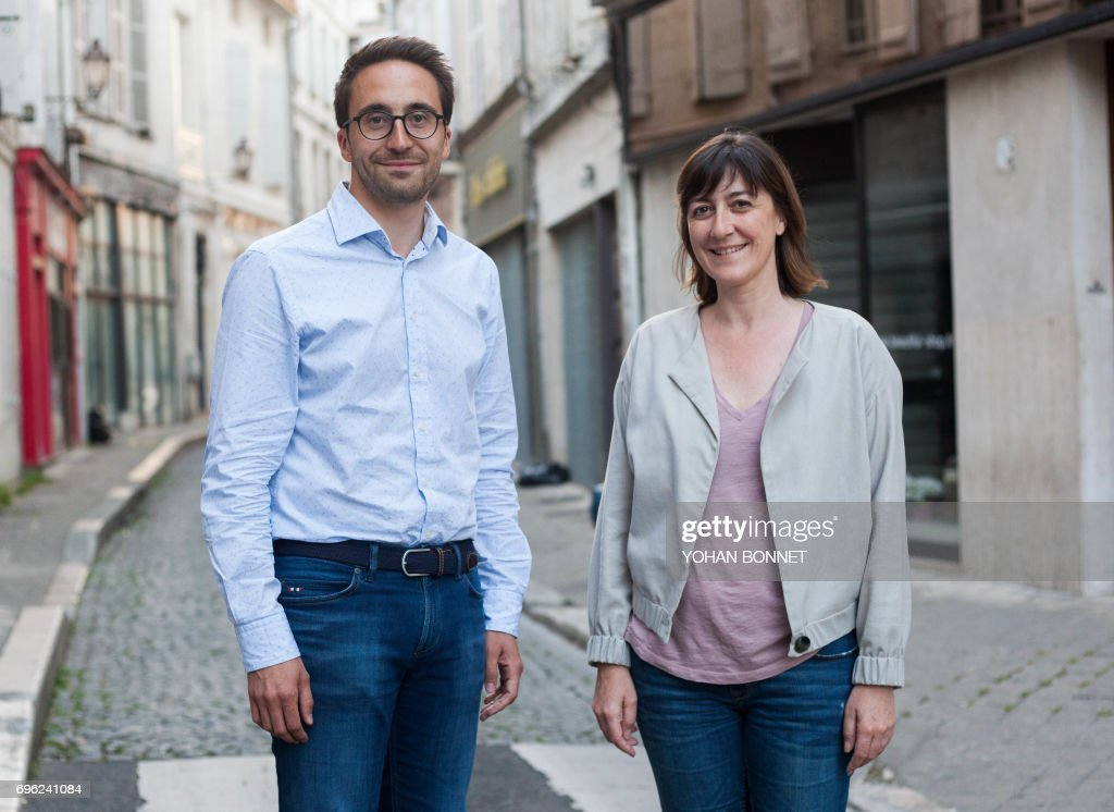 A picture taken on June 12, 2017, shows Sandra Marsaud (R), urbanist, municipal councilor of Saint-Meme-les-Carrieres and French La Republique En Marche (LREM) party candidate in the 2nd constituency of Charente, and Thomas Mesnier, emergency doctor and LREM candidate in the 1st constituency of Charente, posing in Angouleme, central France, ahead of the second round of France's legislative elections. France heads to the polls on June 18, 2017, for the second round of legislative elections, with Macron's year-old La Republique En Marche party and its allies tipped to clean up for the 577-member lower house of parliament, winning up to 445 seats. / AFP PHOTO / Yohan BONNET