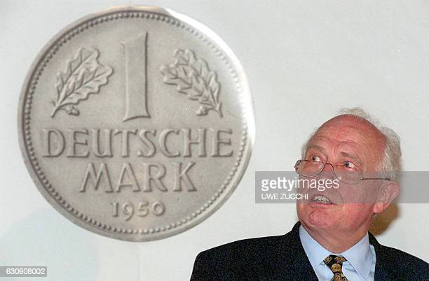 Picture taken on June 15 1998 in Kassel western Germany shows then president of the German central bank Bundesbank Hans Tietmeyer next to a giant...