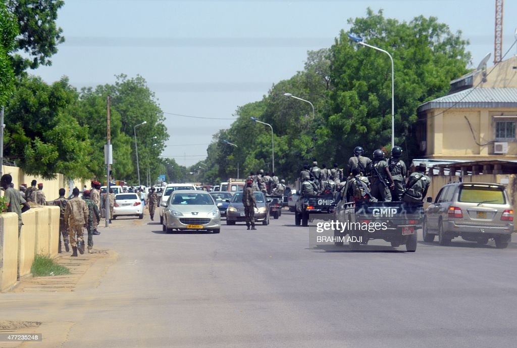 A picture taken on June 15 2015 shows police forces and soldiers patrolling outside the police headquarters in N'Djamena in which 23 were killed...