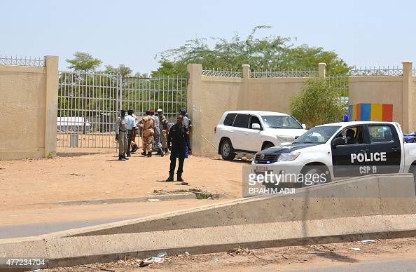 A picture taken on June 15 2015 shows police forces outside the police headquarters in N'Djamena in which 23 were killed along with a simultaneous...