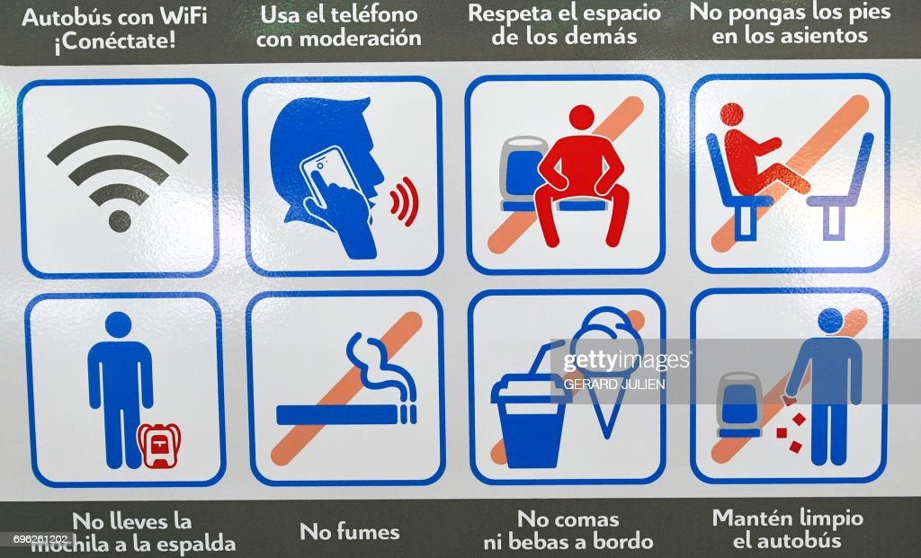 A picture taken on June 15, 2017 in a bus of Madrid Municipal Transport company (EMT) shows a serie of pictograms including a new one, the anti-manspreading one (Top 2nd right). An anti-manspreading campaign starts on June 15, 2017 in Madrid city's busses. /