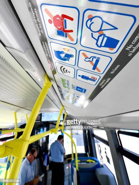 A picture taken on June 15 2017 in a bus of Madrid Municipal Transport company shows a serie of pictograms including a new one the antimanspreading...