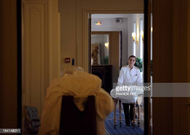 A picture taken on June 15 shows a chambermaid in a corridor of the luxury hotel 'Hotel du Palais' in Biarritz Southwestern France This hotel became...