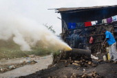 A picture taken on June 16 2013 shows waste matter discharging from a 'chang'aa' distillery in the Mathare slum of Nairobi Chang'aa is a potent...