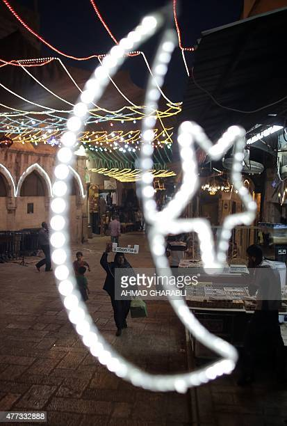 A picture taken on June 16 2015 shows fairy lights decorating a shop near the entrance of the AlAqsa mosque compound in the old city of Jerusalem as...