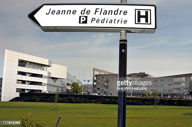 A picture taken on June 17 2011 in Lille northern France shows a road sign indicating the way to go to the paediactrics service of the Jeanne de...
