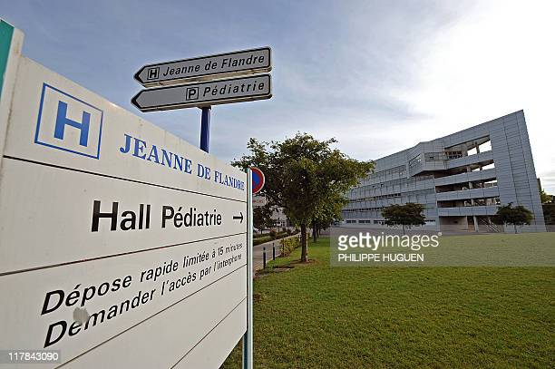 A picture taken on June 17 2011 in Lille northern France shows a road signs indicating the way to go to Jeanne de Flandre hospital where are...