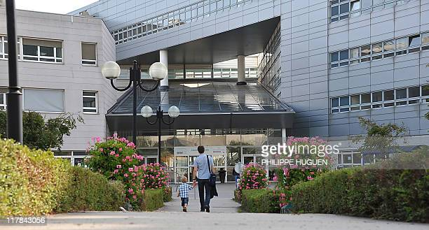 A picture taken on June 17 2011 in Lille northern France shows persons walking towards the Jeanne de Flandre hospital where are hospitalised seven...