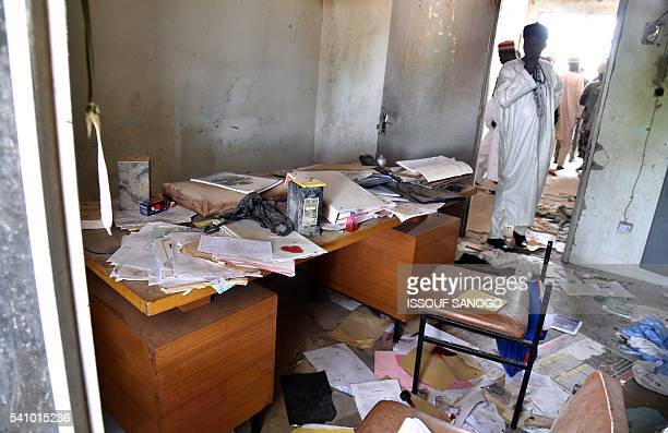 A picture taken on June 17 2016 shows ransacked administration offices in Bosso after June 6 attacks by Boko Haram Rotting bodies looted buildings...