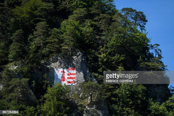 A picture taken on June 18 2017 in Moutier northern Switzerland shows a flag of Jura canton painted on the mountain overlooking the village during an...