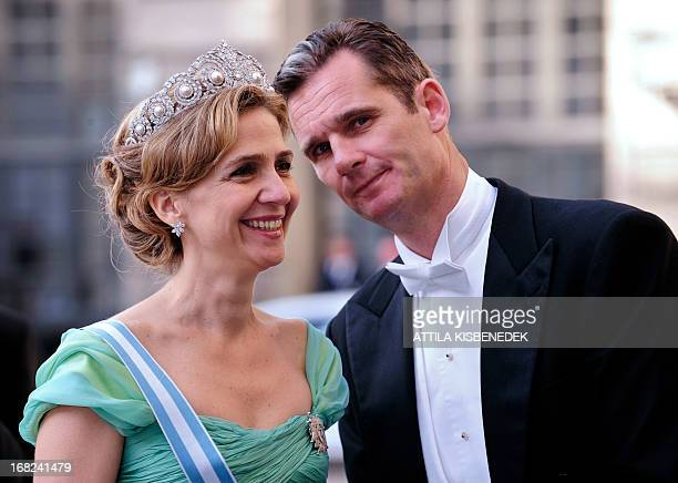 A picture taken on June 19 2010 shows Infanta Cristina of Spain and her husband Inaki Urdangarin arriving at the wedding banquet of newlywed Swedish...