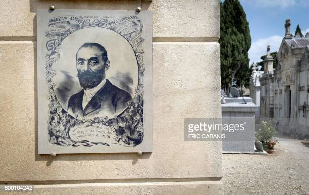 A picture taken on June 19 2017 in Argeliers shows a memorial plaque on the grave of Marcelin Albert cafe owner and winegrower regarded as one the...
