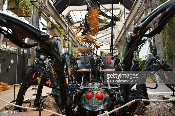 A picture taken on June 20 20107 shows a mechanical heron made of wood and a steel flying over a spider at the Machine Gallery of 'Les Machines de...