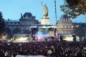 STORY A picture taken on June 21 1990 shows Parisian and tourists gathering at the place de la Republique in Paris to attend an open air concert of...