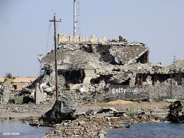 A picture taken on June 21 2014 in the city of Ramadi west of the capital Baghdad shows a building that was damaged during the fightings between the...