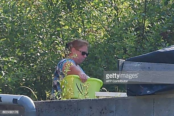 A picture taken on June 21 2017 shows Murielle Bolle appearing in the garden at her home in GrangessurVologne eastern France Bolle is the sister in...