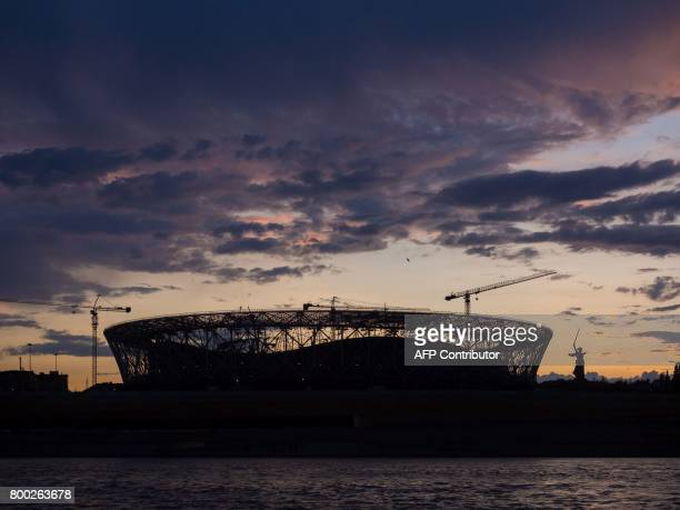 A picture taken on June 21 2017 shows the Volgograd Arena football stadium under construction for the 2018 FIFA World Cup with the statue of Mother...