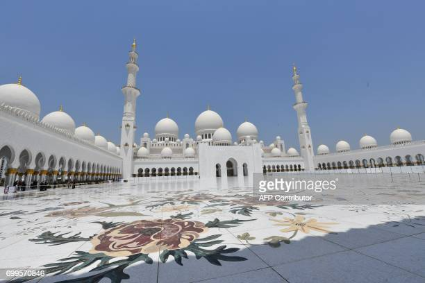 A picture taken on June 21 shows the Sheikh Zayed Grand Mosque in Abu Dhabi United Arab Emirates / AFP PHOTO / GIUSEPPE CACACE