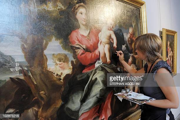 ' LA REVOLUTION A L'ITALIENNE DU PALAIS FESCH MUSEE DES BEAUXARTS D'AJACCIO3 A picture taken on June 22 2010 shows a person restoring a painting at...