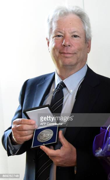 Picture taken on June 22 2014 shows US economist Richard Thaler presenting his 2014 Global Economy Prize during the award ceremony in Kiel northern...