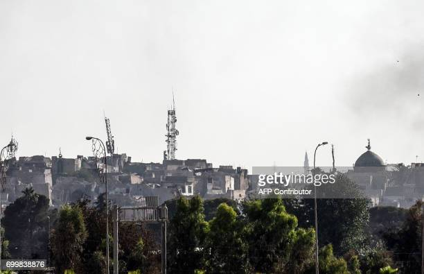 TOPSHOT A picture taken on June 22 2017 shows Mosul's skyline missing it's trademark leaning AlHadba minaret the day after it was blown up by Islamic...