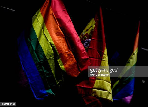 TOPSHOT A picture taken on June 22 2017 shows rainbow flags in Madrid's Chueca district on the eve of the start of the WorldPride 2017 Some three...