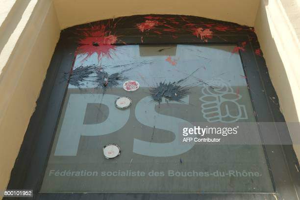 A picture taken on June 23 2017 in Marseille southern France shows the vandalized building of the Federation Socialiste des Bouches du Rhone / AFP...