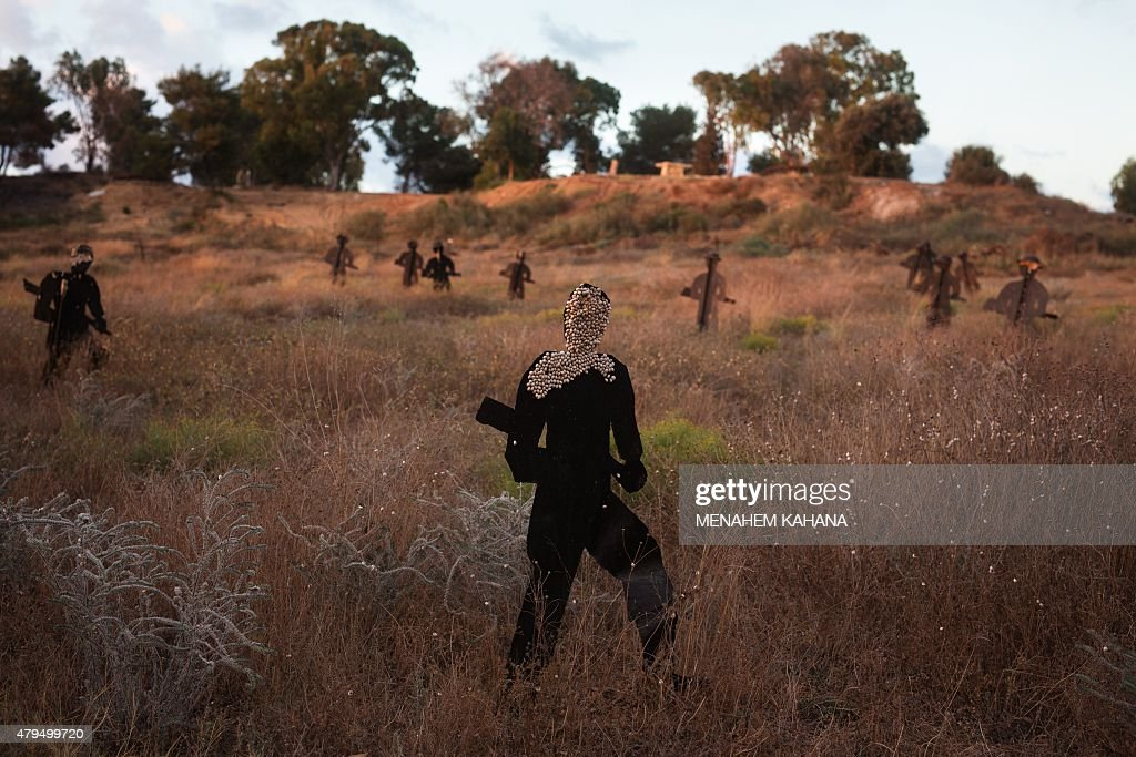 A picture taken on June 23 shows metallic silhouettes representing Egyptian soldiers taking part in the battle between Israel and Egypt during the...