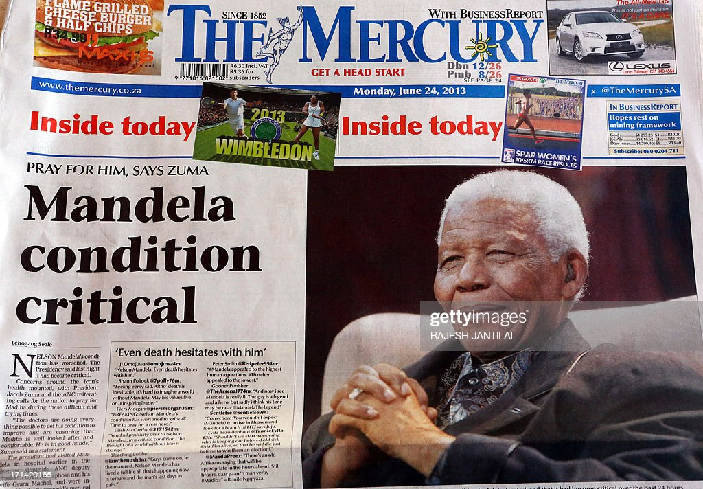 A picture taken on June 24, 2013 in Durban shows a headline in one of the local newspapers in Durban whose front pages carry headlines of Nelson Mandela being in a critical condition in hospital. Nelson Mandela is in a critical condition in hospital, South Africa's presidency said late on June 23, marking a sudden and significant deterioration in the health of the former leader and anti-apartheid hero.