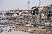 A picture taken on June 24 2014 in the city of Ramadi in the Anbar province shows buildings that were damaged during fightings between government...