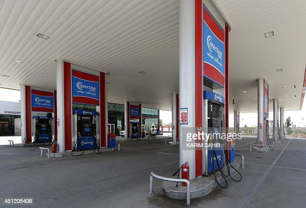 A picture taken on June 25 2014 in Arbil the capital of the autonomous Kurdish region of northern Iraq shows a deserted empty gas station following...