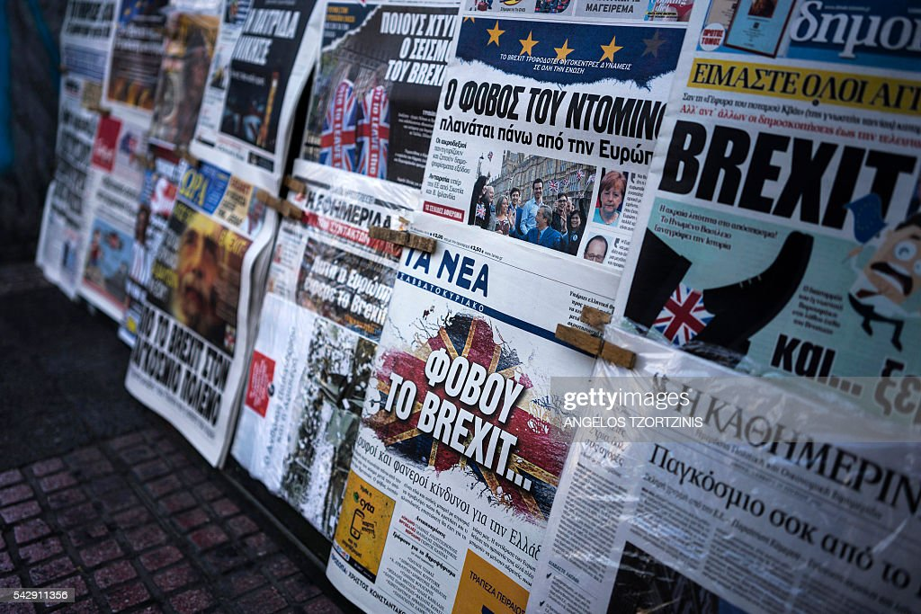 A picture taken on June 25, 2016 in Athens shows the front page of the Greek newspaper 'Ta Nea' reading 'be afraid of Brexit' and other newspapers bearing headlines reporting the result of the UK's vote to leave the EU in the June 23 referendum. The pound plunged and world stock markets slumped on June 24, 2016 after Britain's shock vote to leave the European Union, fuelling a wave of global uncertainty. Sterling crashed 10 percent to a 31-year low at one point and the euro also plummeted against the dollar, as the Brexit result caught markets by surprise. / AFP / Angelos Tzortzinis