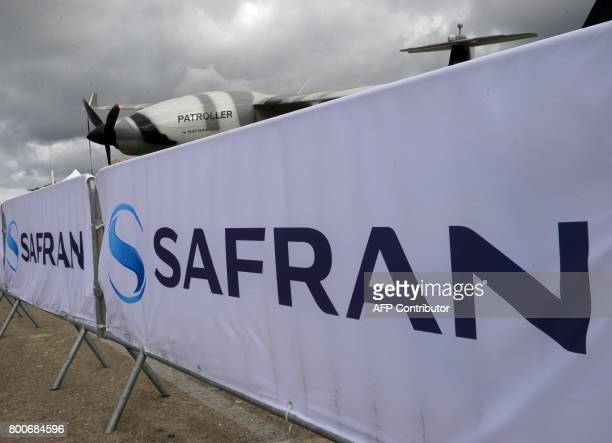 A picture taken on June 25 2017 shows the logo of French aerospace engineering company Safran on the Safran stand at Le Bourget during the...