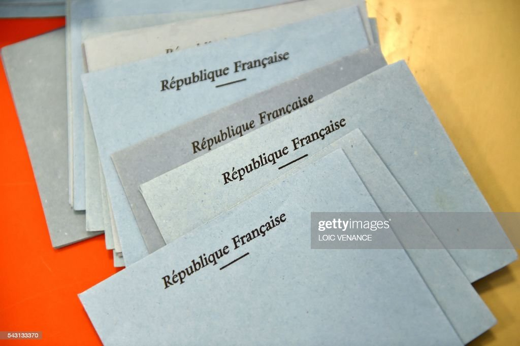 A picture taken on June 26, 2016 in Notre-Dame-des-Landes during a local referendum organised in Loire-Atlantique on subject of the Notre-Dame-des-Landes' airport project shows the ballots. Nearly One million people living in France's Loire-Atlantique department are voting in a referendum which poses the question 'Are you in favour of the project to transfer the Nantes-Atlantique airport to the municipality of de Notre-Dame-des-Landes?' to voters. The referendum was organised by the French executive power hoping to find a solution to the issue which has dragged on for 50 years. / AFP / LOIC