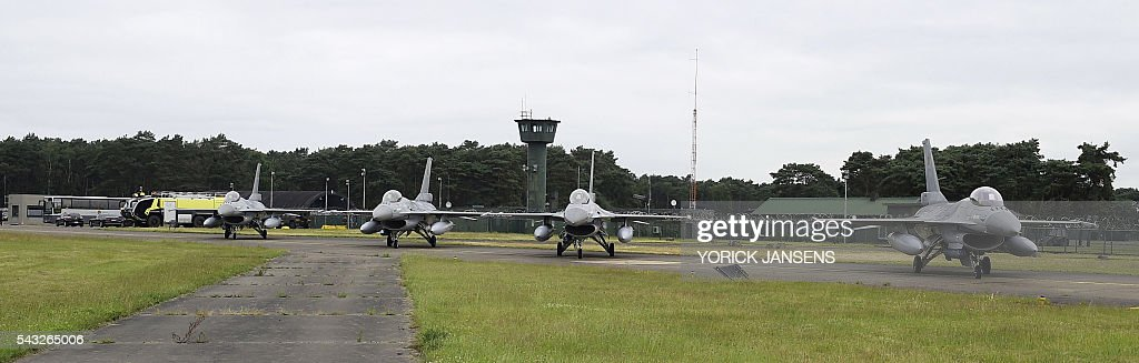 A picture taken on June 27, 2016 shows the departure of six planes of the Belgian army, F-16 fighter jets at themilitary airbase in Kleine Brogel, Peer to participate in the Operation Guardian Falcon (ODF) as part of the international mission against Islamic State (IS) in Middle East / AFP / BELGA / YORICK JANSENS / Belgium OUT