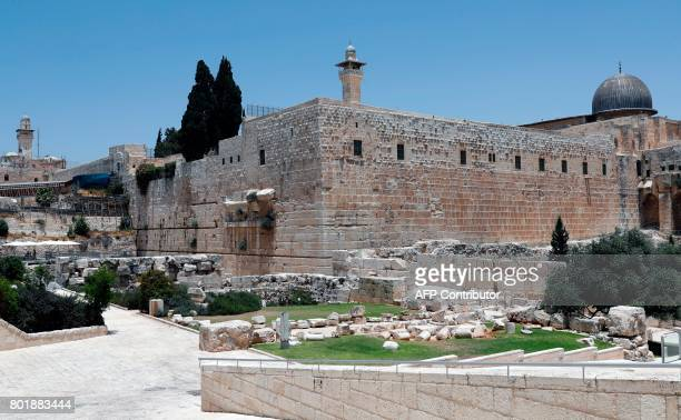 A picture taken on June 27 2017 shows the rightpart of the Western Wall with the dome of AlAqsa mosque seen on the right of the photo taken from the...