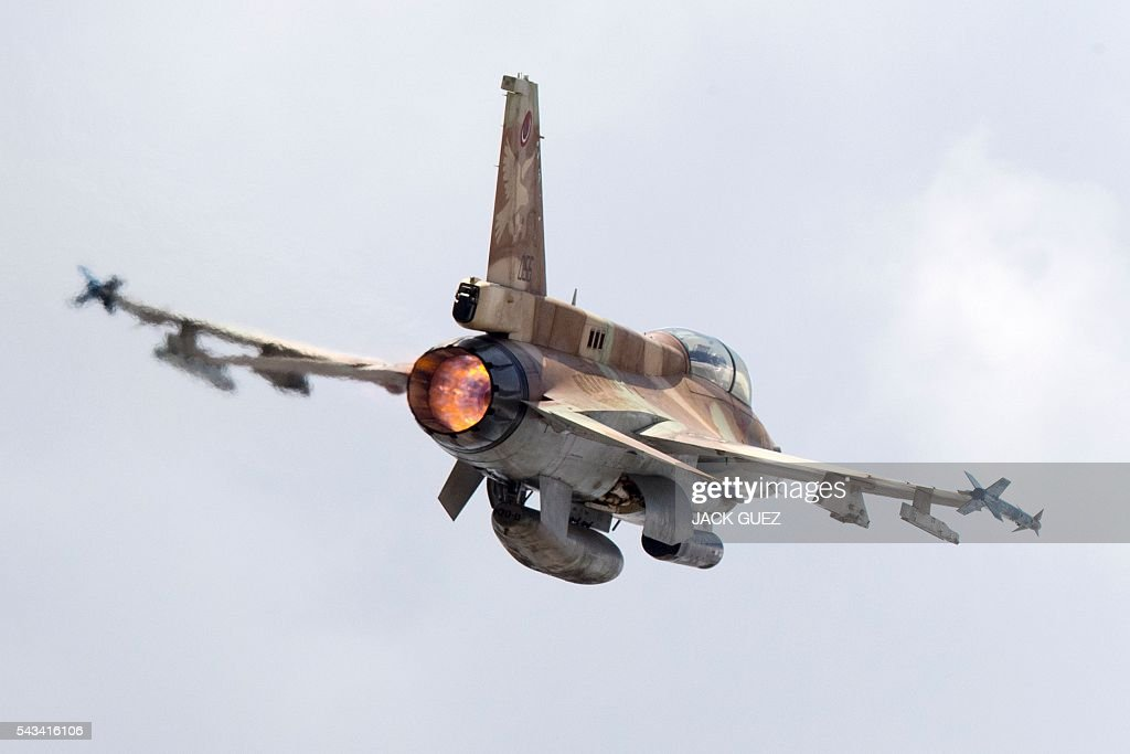 A picture taken on June 28, 2016 shows an Israeli Air Force F-16 D fighter jet taking off at the Ramat David Air Force Base located in the Jezreel Valley, southeast of Israeli port city of Haifa. / AFP / JACK