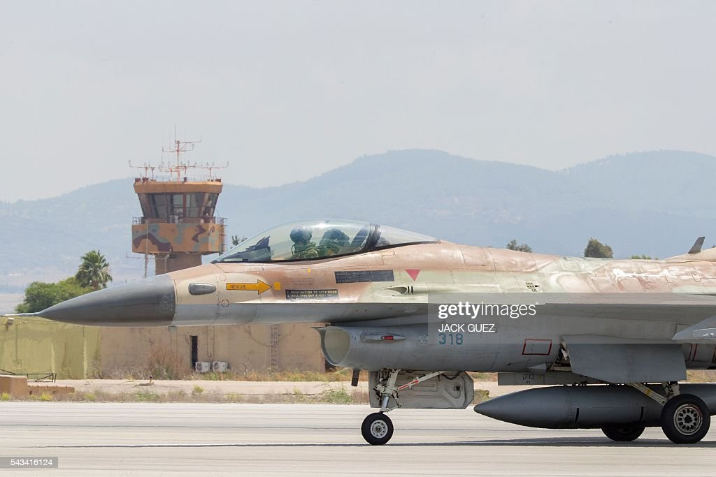 A picture taken on June 28, 2016 shows an Israeli Air Force F-16 fighter jet preparing to take off at the Ramat David Air Force Base located in the Jezreel Valley, southeast of Israeli port city of Haifa. / AFP / JACK
