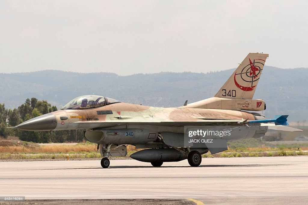 A picture taken on June 28, 2016 shows an Israeli Air Force F-16 fighter jet preparing to take off at the Ramat David Air Force Base located in the Jezreel Valley, southeast of the Israeli port city of Haifa. / AFP / JACK