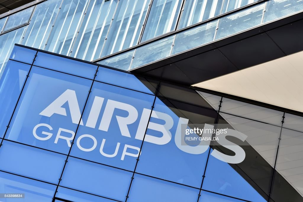 A picture taken on June 28, 2016 shows the logo of Airbus company written on the frontage of the new headquarters of Airbus Group in Blagnac, on the outskirts of Toulouse. / AFP / Rémy GABALDA