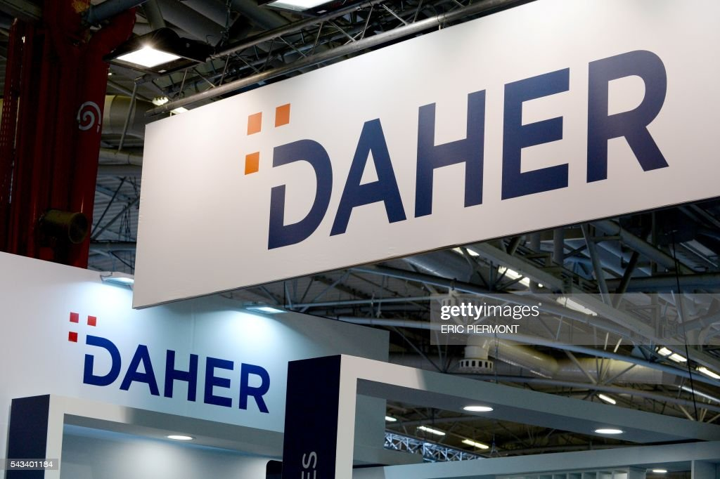 A picture taken on June 28, 2016 shows the logo of French industrial conglomerate and aerostructures company Daher taken at the World Nuclear Exhibition in Le Bourget, near Paris. / AFP / ERIC