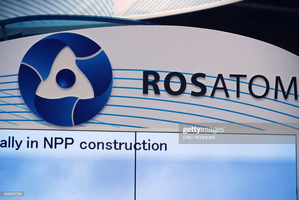 A picture taken on June 28, 2016 shows the logo of Russian atomic energy agency Rosatom during the World Nuclear Exhibition in Le Bourget, near Paris. / AFP / ERIC