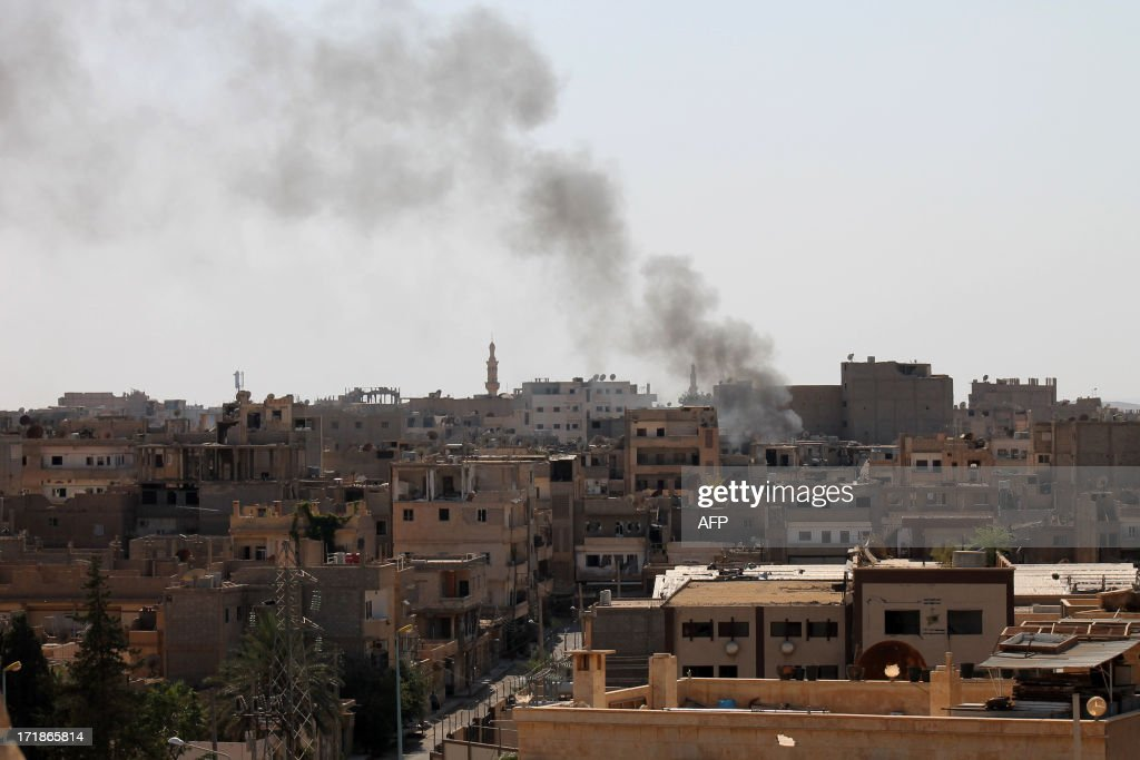 A picture taken on June 29, 2013 shows smoke rising from buildings following an airstrike by government forces on Syria's northeastern city of Deir Ezzor. In 27 months, more than 100,000 people have died in the conflict, which morphed from a popular movement for change into an insurgency after the regime unleashed a brutal crackdown on dissent.