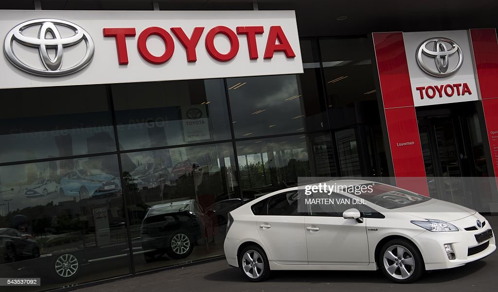 A picture taken on June 29, 2016 shows a car on display at a Toyota car dealership in the Hague, The Netherlands. Toyota said on June 29, 2016 it is recalling 3.37 million vehicles globally over a pair of defects, in the latest hit for a Japanese auto industry hit by fuel-efficiency scandals and an exploding airbag crisis. / AFP / ANP / Marten van Dijl / Netherlands OUT
