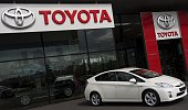 A picture taken on June 29 2016 shows a car on display at a Toyota car dealership in the Hague The Netherlands Toyota said on June 29 2016 it is...