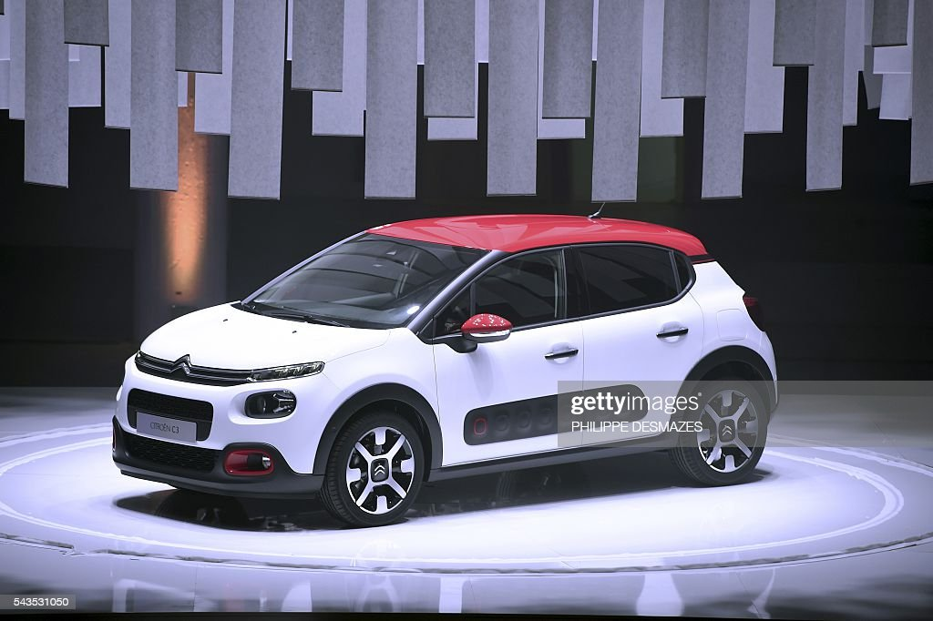 A picture taken on June 29, 2016 shows the new Citroen C3 during its presentation in Lyon. / AFP / PHILIPPE
