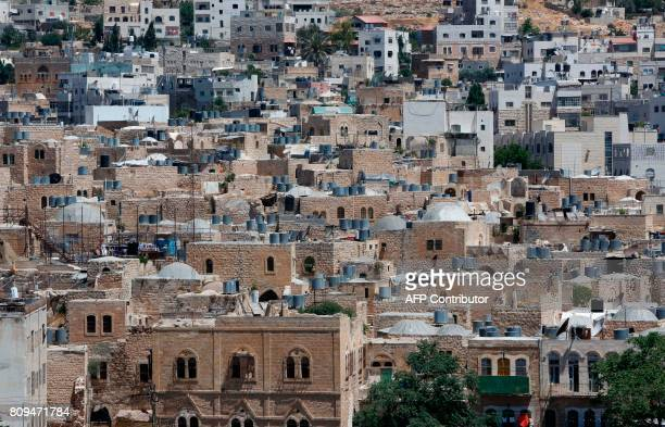 A picture taken on June 29 2017 shows a view of the houses in the old town of the divided city of Hebron in the southern West Bank On July 7 2017...